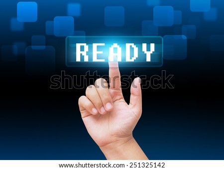 Hand pressing ready buttons with technology background  - stock photo