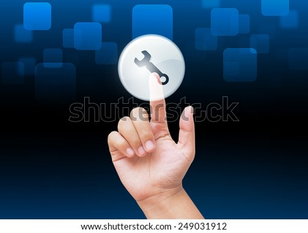 Hand pressing repair or tool buttons with technology background  - stock photo