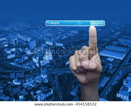 Hand pressing search www button over city tower background, Searching system and internet concept