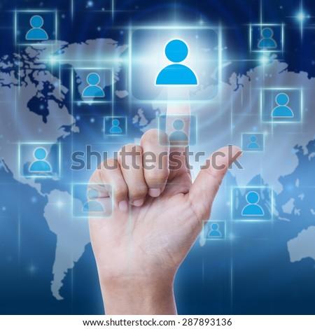 Hand pressing Social Network icon on virtual screen. - stock photo