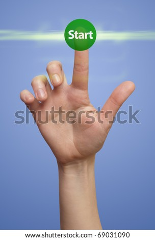 Hand pressing START buttons - stock photo