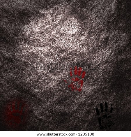 Hand prints upon a cave wall - stock photo