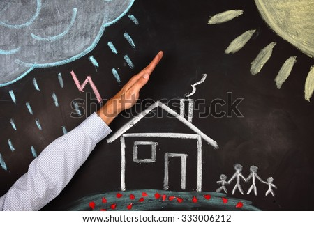 hand protect a house  - stock photo