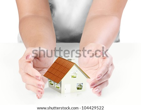 hand Protect Your House   on white background - stock photo