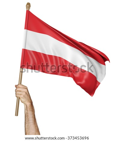 Hand proudly waving the national flag of Austria - stock photo