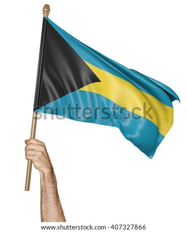 Hand proudly waving the national flag of Bahamas, 3D rendering - stock photo