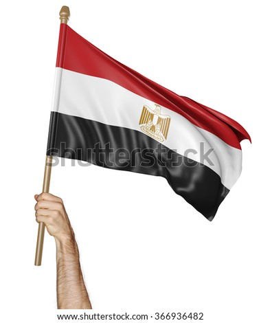 Hand proudly waving the national flag of Egypt - stock photo