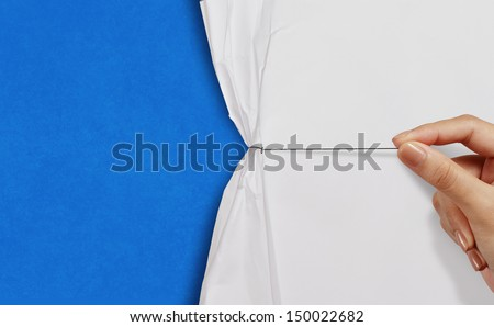 hand pull rope open wrinkled paper show blue background as business concept - stock photo