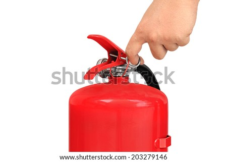 Hand pulling pin of fire extinguisher - stock photo