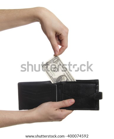 hand-pulling the dollar from purse isolaetd - stock photo