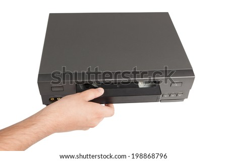 hand pulls videocassette from videorecorder isolated on white background - stock photo