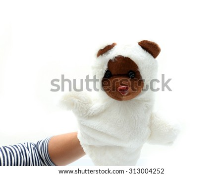 Hand puppet of bear for child on white background.
