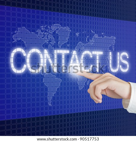 hand push contact us button on touch screen with world map background - stock photo