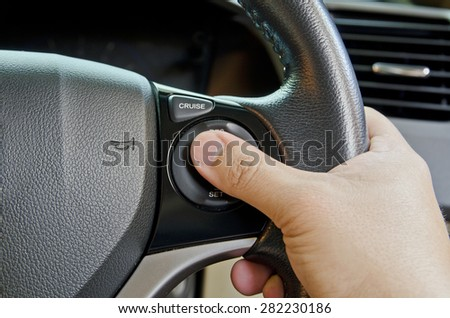 Hand push Cruise Control. - stock photo