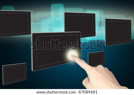 hand push on touch screen of tablet pc