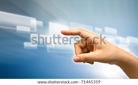 Hand pushing a button on a modern touch screen
