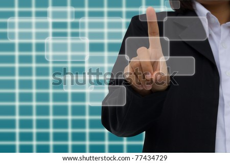 hand pushing a button touch screen - stock photo