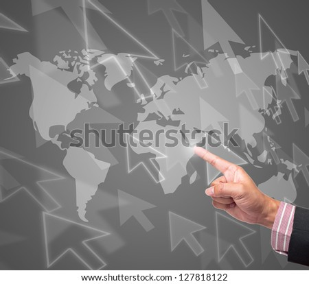 Hand pushing arrow button on a touch screen interface - stock photo