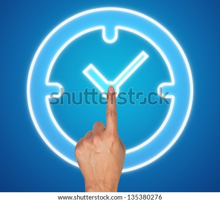 Hand pushing clock button on a touch screen interface - stock photo