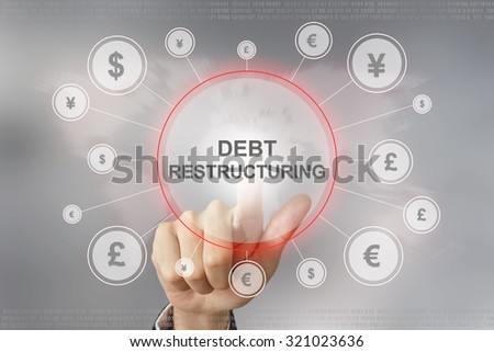hand pushing debt restructuring button with global networking concept