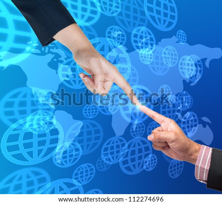 Hand pushing global button on a touch screen interface - stock photo