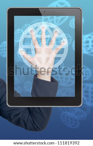 Hand pushing global button on tablet on a touch screen interface - stock photo