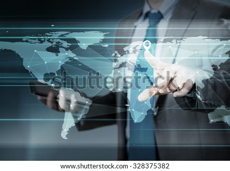 Hand pushing global network button on touch screen interface