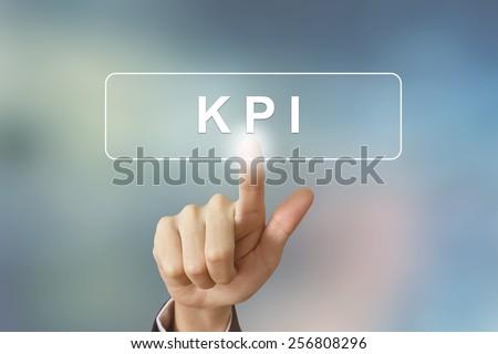 hand pushing KPI or Key Performance Indicator button - stock photo