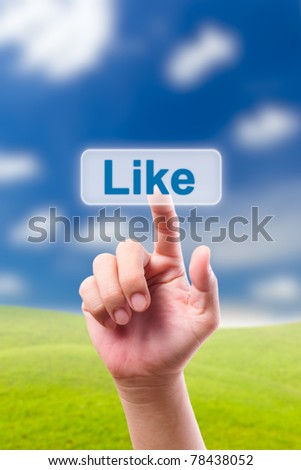 hand pushing like button - stock photo