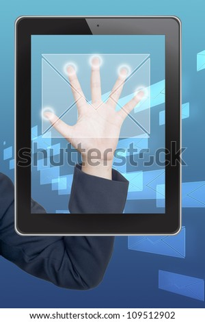 Hand pushing mail icon tablet on a touch screen blank interface - stock photo