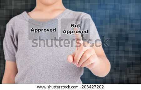 "hand pushing on a touch screen interface ""Not Approved"" - stock photo"