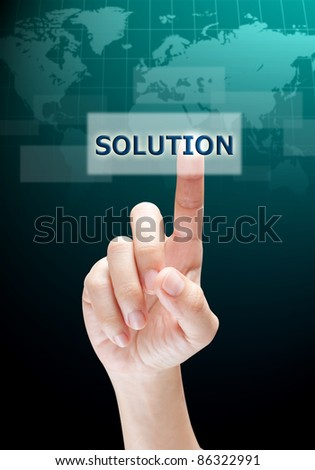 hand pushing on a touch screen interface  solution button - stock photo