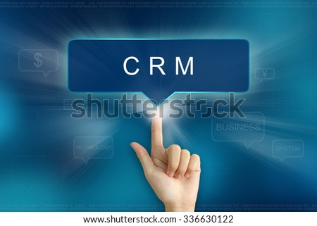 hand pushing on CRM or Customer relationship management balloon text button