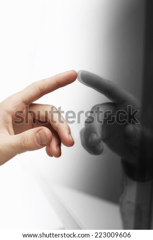 hand pushing on screen interface, close up - stock photo