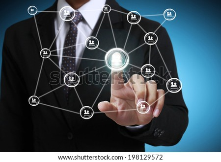 hand pushing social network structure  - stock photo