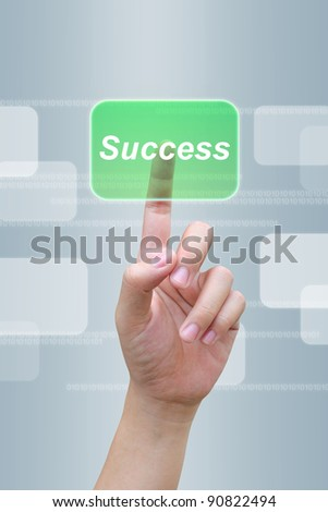 hand pushing success button on a touch screen interface