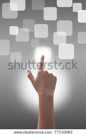 Hand pushing the buttons on Gray background - stock photo