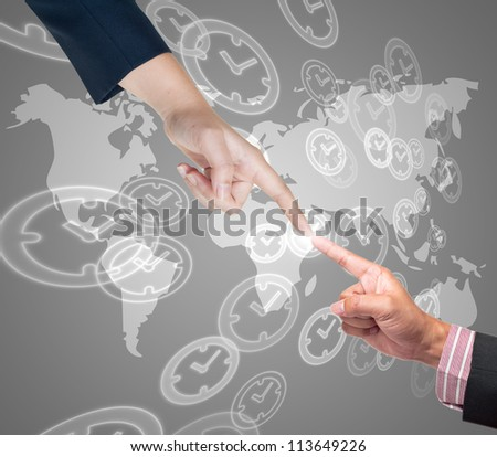 Hand pushing time button on a touch screen interface - stock photo