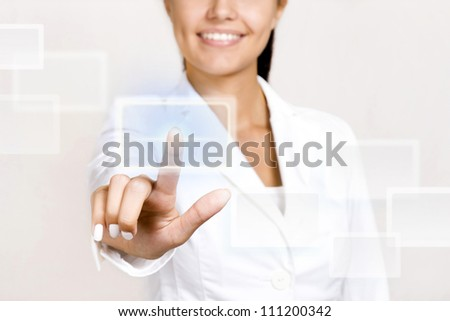 Hand pushing touch screen button. - stock photo