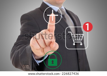 Hand pushing virtual symbol Add or Buy, on line shopping. - stock photo