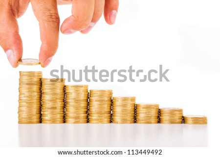 Hand put coin to money staircase , isolated on white - stock photo