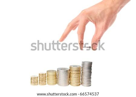hand put coin to money staircase isolated on white - stock photo