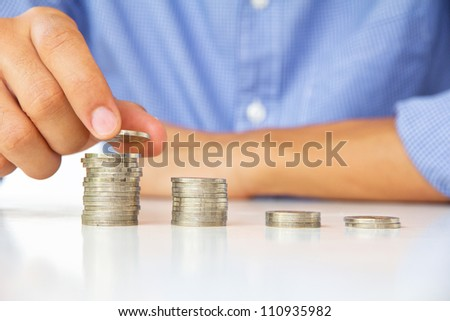 Hand put coin to stack, investment concept - stock photo