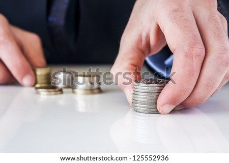 Hand put coin to stack, investment or growth concept - stock photo