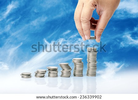 Hand put coins to stack  - stock photo