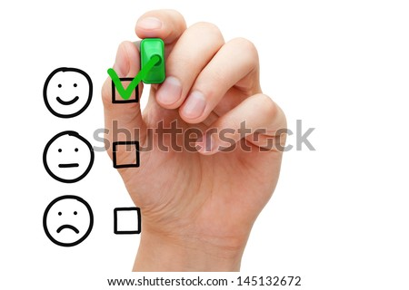 Hand putting check mark with green marker on customer service evaluation form.