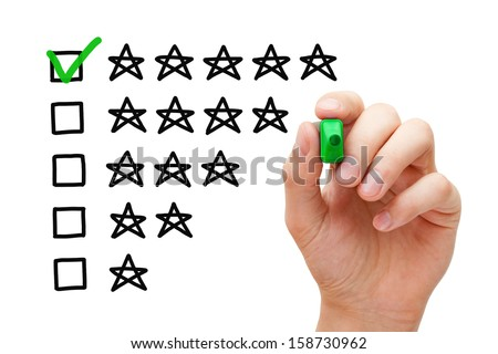 Hand putting check mark with green marker on five star rating. - stock photo