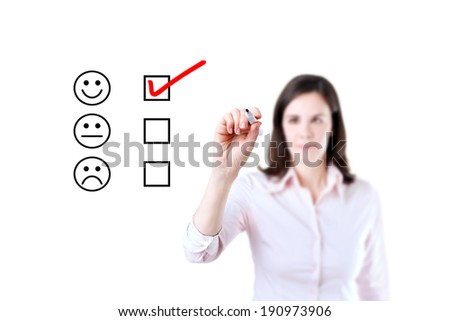 Hand putting check mark with red marker on customer service evaluation form.  - stock photo