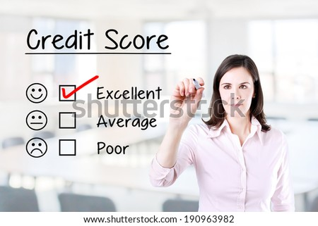 Hand putting check mark with red marker on excellent credit score evaluation form. Office background. - stock photo