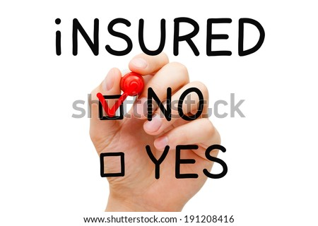 Hand putting check mark with red marker on No Insured. - stock photo